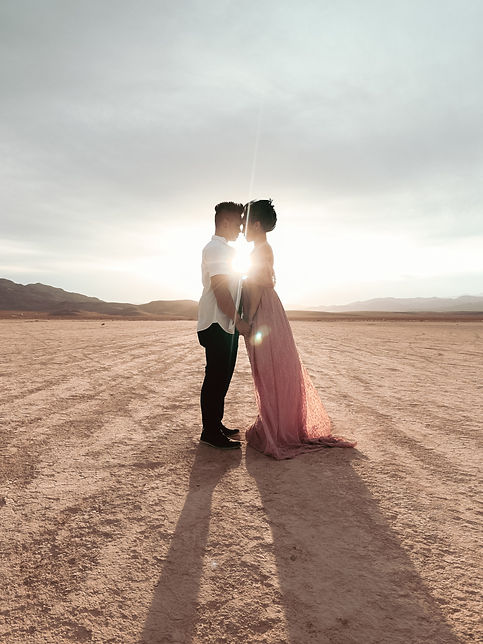 Sunlight glow couple in love in the desert engagement photoshoot Jean Dry Lake Bed, Las Vegas. Photo by Daniela Blagoeva engagement and protrait photographer based in Las Vegas and Sofi, Bulgaria, available worldwide