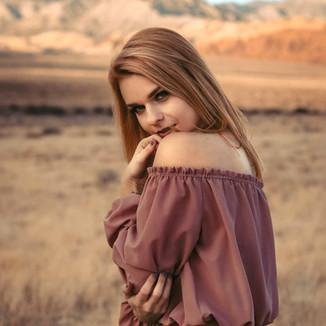 Ginger hair girl portrait in the desert