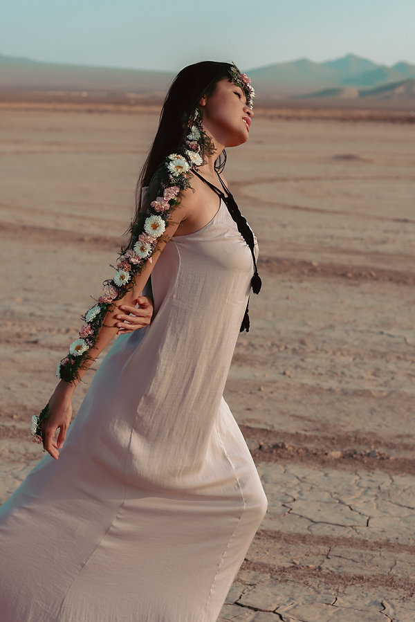 Golden hour sunset creative portrait photography with Phillipino model in Jean Dry Lake Bed, Las Vegas, NV. Photo by Daniela Blagoeva fashion and portrait photographer based in Las Vegas, NV