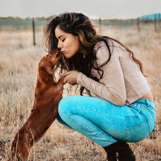 Cute girl and dog portrait photoshoot in desert