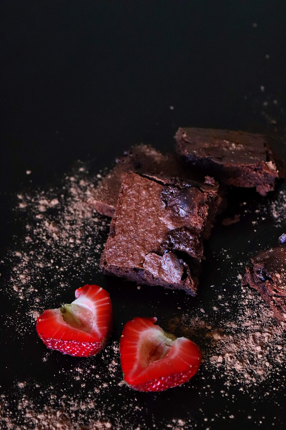 Healthy almond chocolate brownies garnished with strawberries