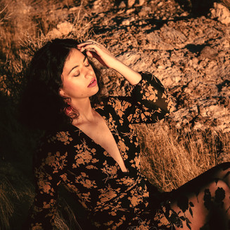 Golden hour fashion editorial photoshoot with beautiful model