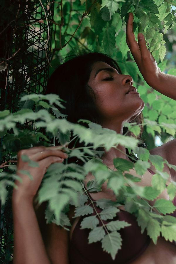 Closeup creative portrait photoshoot in tropical garden with LA model. Photo by Daniela Blagoeva portrait and fashion photographere based in Las Vegas, NV and Sofia, Bulgaria, available worldwide