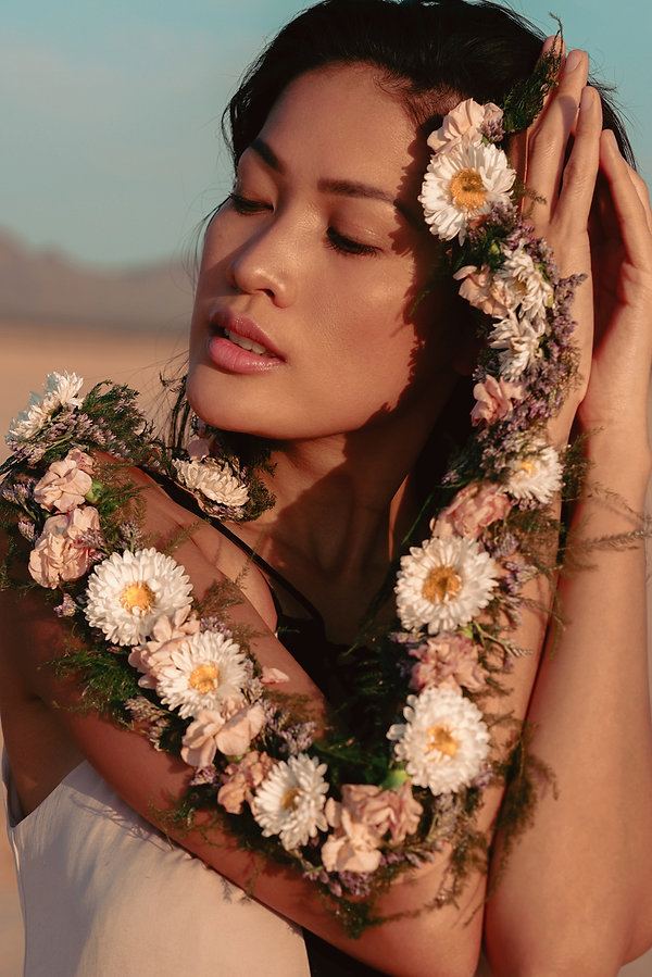 Wearable flowers creative portrait photoshoot with beautiful girl in the desert in Jean Dry Lake Bed, Las Vegas, NV. Photo by Daniela Blagoeva portrait and fashion photographer based in Las Vegas, Bulgaria, and worldwide