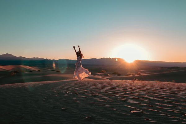 Sunrise early morning fashion travel vacation photoshoot with Riley from travelingwithriley at the sand dunes in Death Valley National Park, California. Photo by Daniela Blagoeva travel destination portrait photographer based in Las Vegas, NV, Sofia Bulgaria, available worldwide
