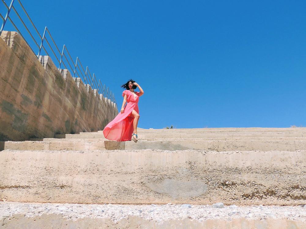 Fashion photo shoot with feminine maxi dress and desert setting.