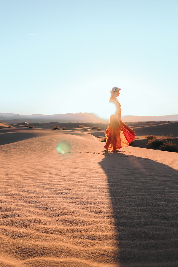 Golden hour flowy dress fashion travel photoshoot with beautiful girl on top of sand dunes in Death Valley National Park, CA. Photo by Daniela Blagoeva travel destination portrait photographer based in Las Vegas, Sofia Bulgaria, available for travel worldwide
