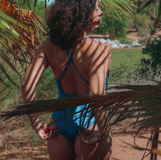 Palm leaves shadows on swim suit model