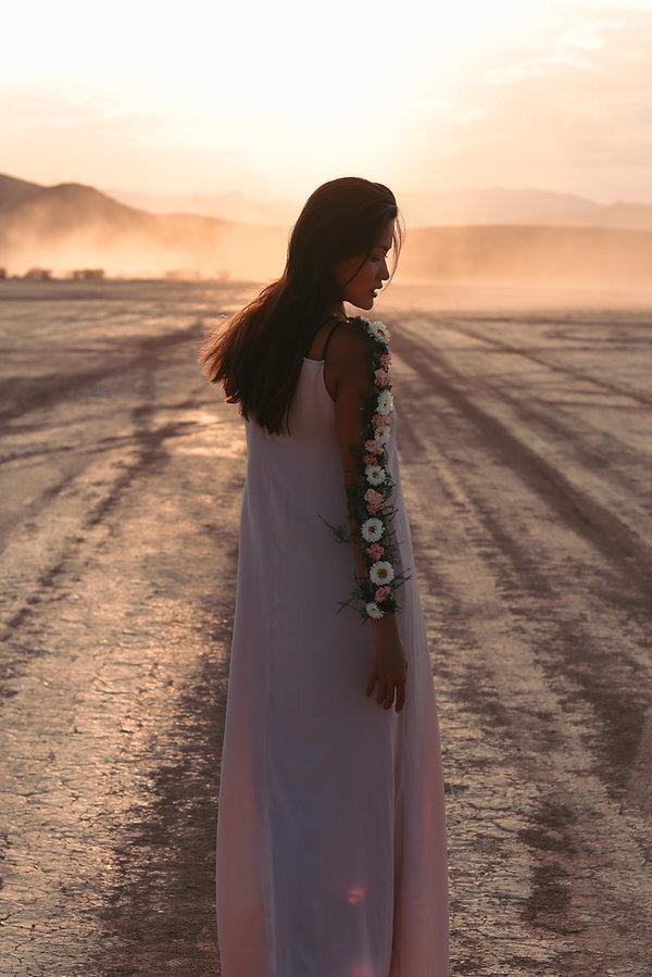Boho chic sunset portrait photoshoot of girl in flowy dress, Jean Dry Lake Bed, Las Vegas, NV. Photo by Daniela Blagoeva portrait fashion photographer based in Las Vegas, NV and worldwide