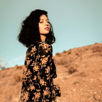 Pretty girl in the desert fashion photoshoot