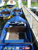 Blue hire boat moored up at Hampton Ferry Boathouse