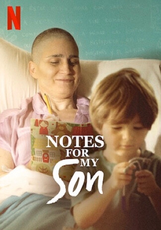 A woman lays in a hospital bed with her son in front of her; the photo is focused upon the woman while the son's appearance is slightly out of focus to enhance her importance. She reads a book while he plays with a toy, the boy's face depicting concentration as his mother is smiling. The colour scheme is warm — filled with orange and beige tones, the only contrast being the woman's pink hospital gown.
