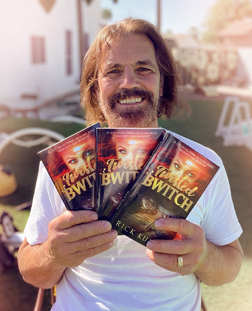 The author Rick Kurtis, holding his new book - Twisted Bwitch