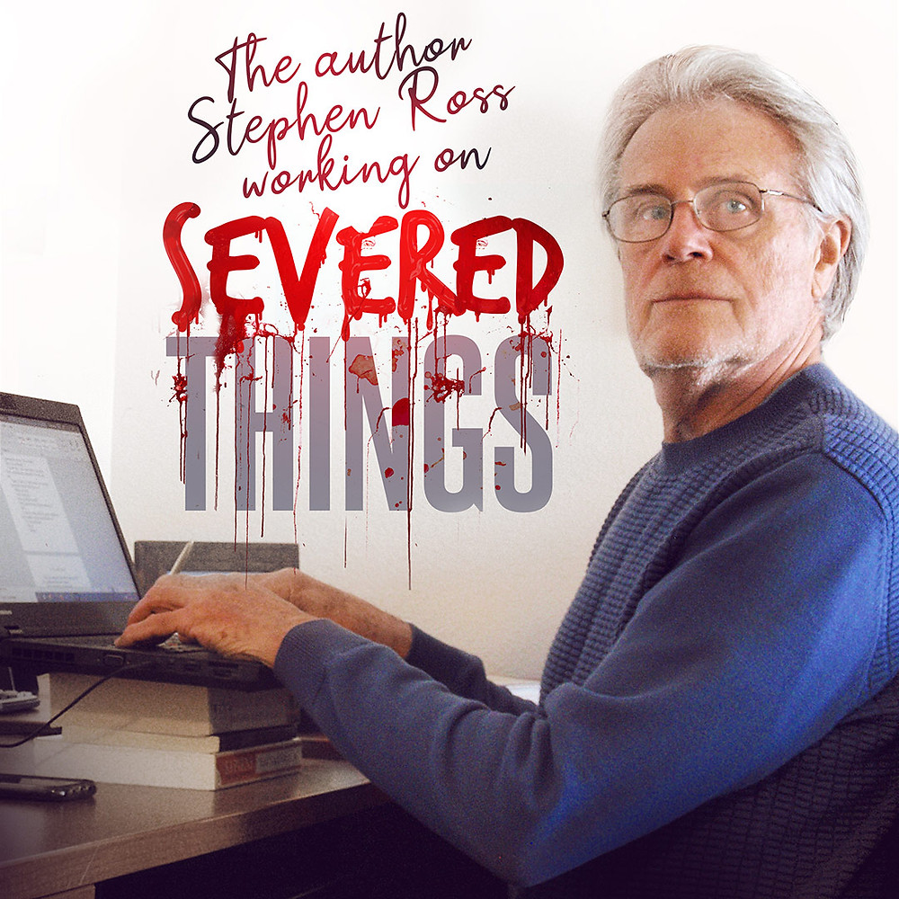 Stephen Ross writing on his laptop