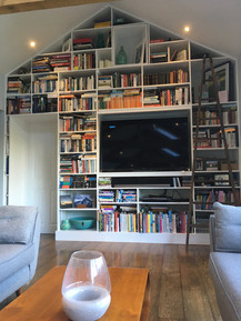 Floor to ceiling alcove unit. With secret square loft door at the top and made to measure television and sound bar shelves
