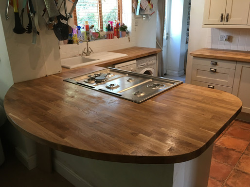 Rounded solid oak breakfast bar and worktops