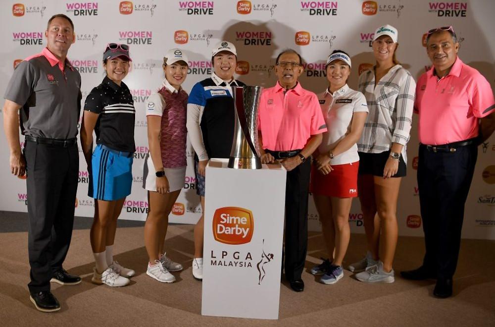 (L-R) Mike Wahn, Natasha Oon, Kelly Tan ,Shan Shan Feng, Tun Musa Hitam, So-Yeon Ryu and Anna-Nordqvist