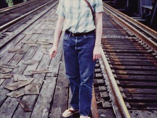 Teenager On A Train Trestle Bridge