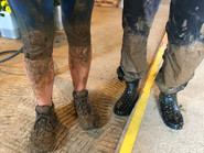 Roots employees' muddy feet