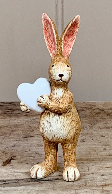 Rustic Rabbit Holding a White Heart