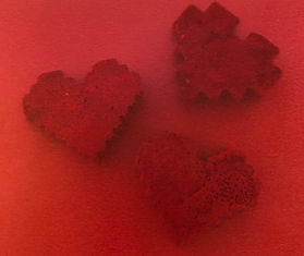Red Relics | plaster, paper | handheld art by Bojana Randall | 8-bit heart art, 16-bit heart sculptures