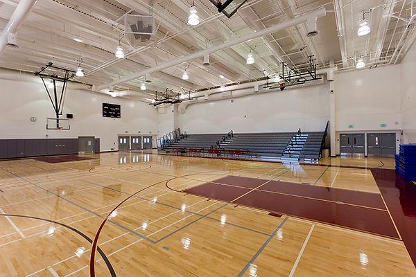 RFK high school gym white interior architecture