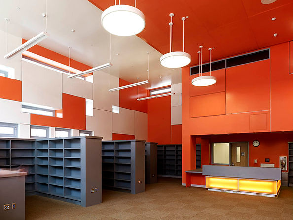 RFK School K-5 colorful orange and white library