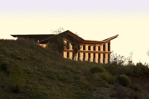 community senior center architecture set into mountain landscape