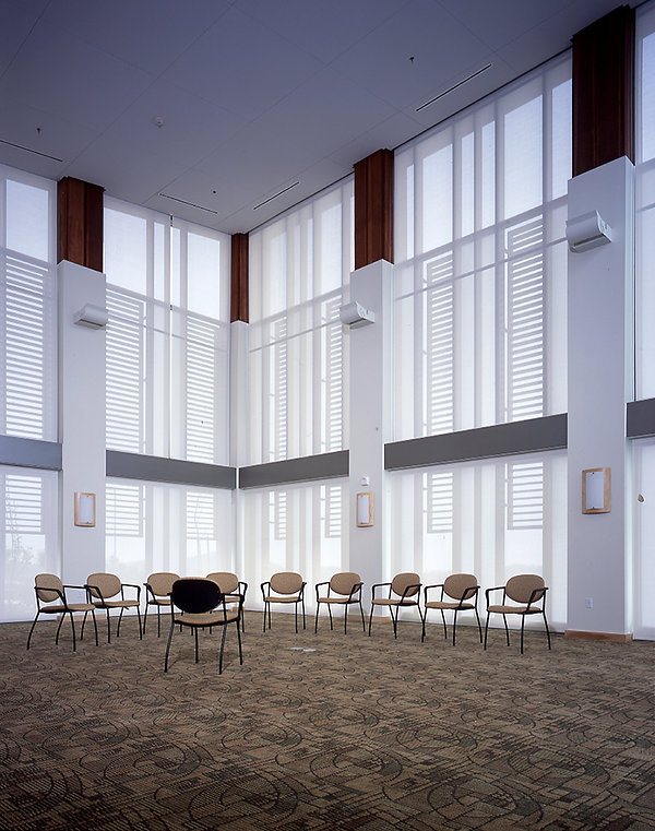 community senior center high-ceilinged white and wood interior design