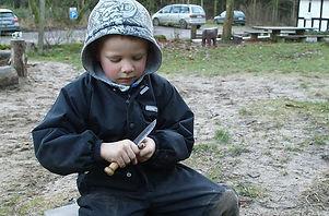Danish forest kindergarten boy with knife