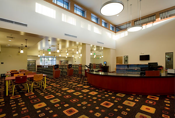 Children's library interior architecture with clerestory lighting red desk