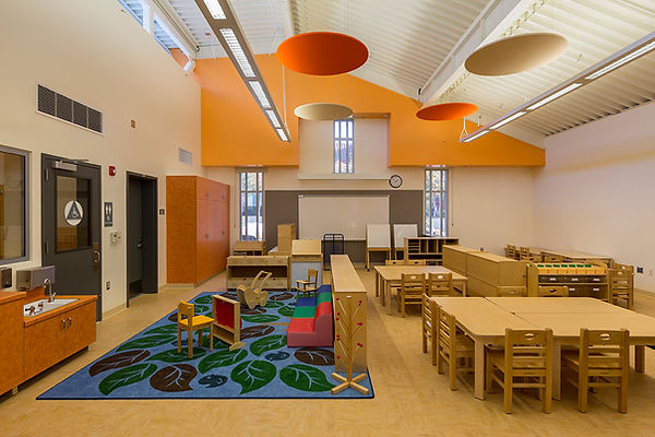 High ceiling, light monitor, colorful interior design early education center