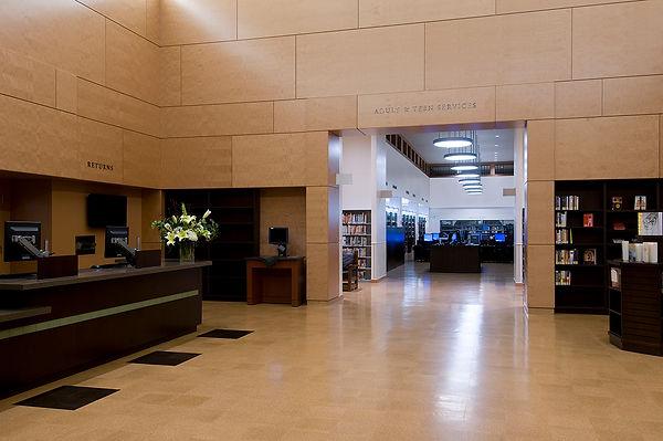 Monrovia Library daylit, wood wall, cork floor circulation hall interior architecture