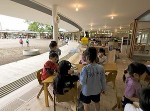 Fuji Kindergarten Tezuka multi-level, indoor outdoor kindergarten around trees