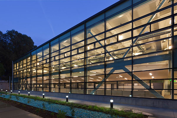 North all-glass wall, braced frame, night view