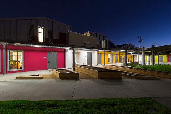 Night view of play courtyard early education architecture