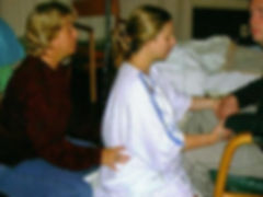 Brenda (doula) helping laboring mom and dad through labor