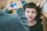 Kid taking a portrait of classmate
