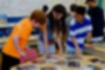 kids looking at photographs