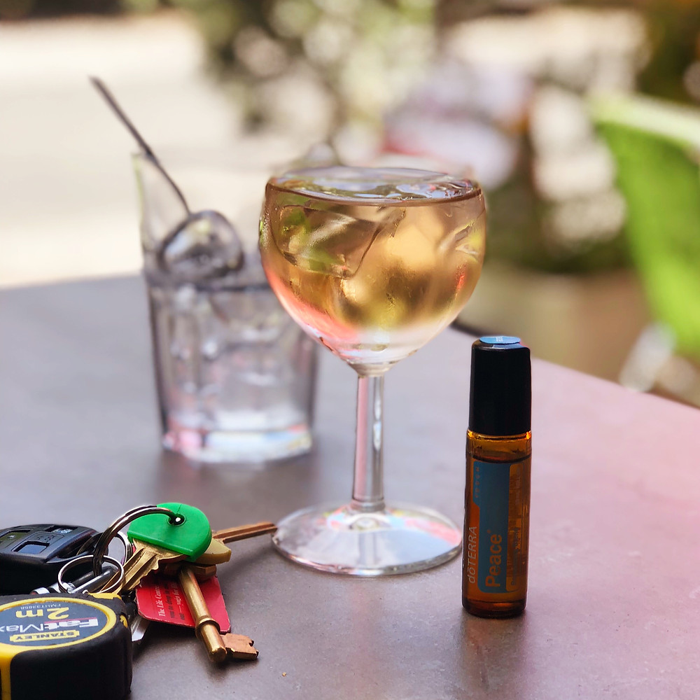 Glass of wine, keys and an essential oil