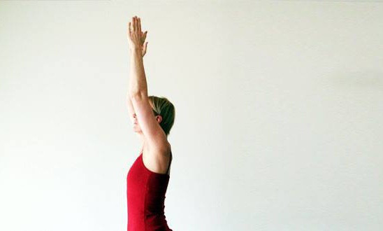 Arms up in yoga posture