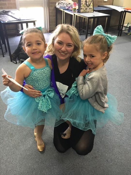 Miss Jemma with students