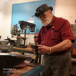 Bruce is metalsmithing