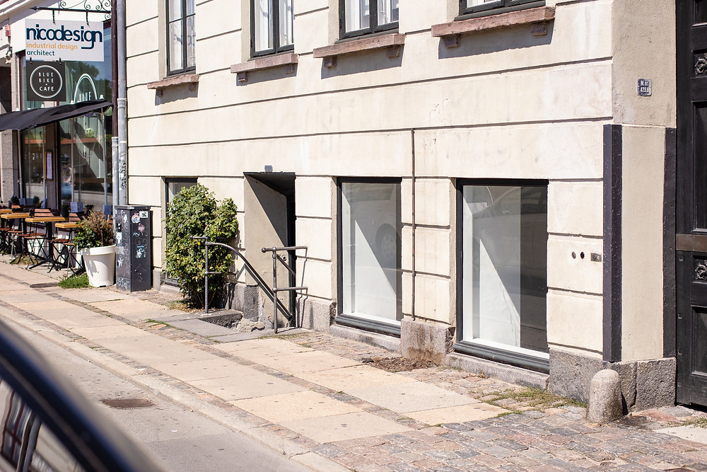 Right next to a Greek coffeeshop in the center of the city. Behind Kongens Have (The Kings Garden) You will find our new tattoo shop; Handshake Studio. Logos are soon to come on those windows!