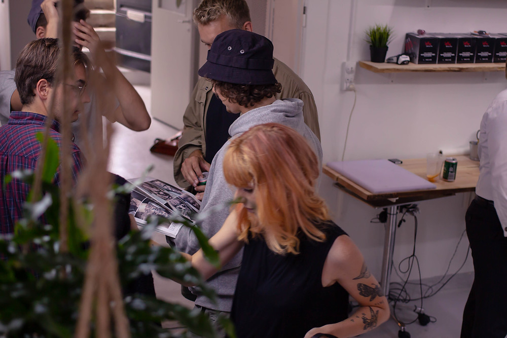 Guests looking at tattoos in Handshake's new studio. Sølvgade 34, Copenhagen K.