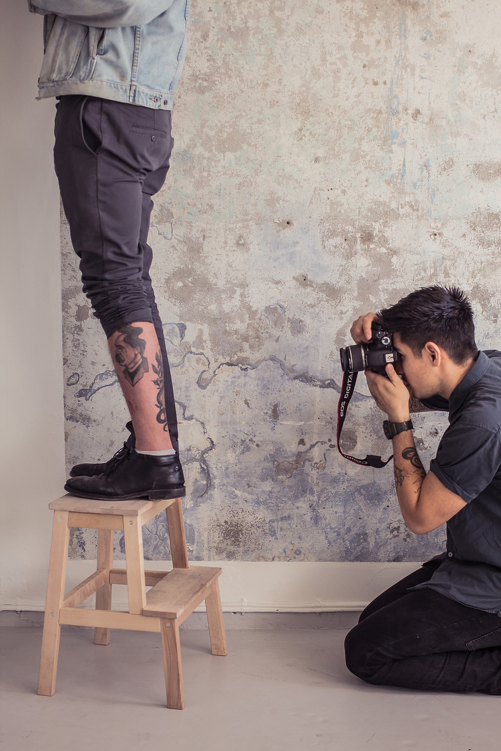 Mike Ho taking a picture of a new tattoo in the new studio - Handshake Studio