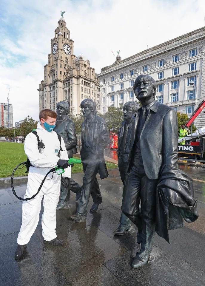 """Vaxinol spraying the Beatles statue on the Liverpool waterfront. Covid19. """"We spray you, Yeh, Yeh Yeh"""""""