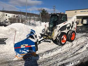 BOBCAT SKID LOADER WITH KAGE SNOW PUSHER.jpeg