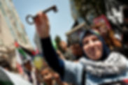 Refugees -- Woman marching with key.jpg
