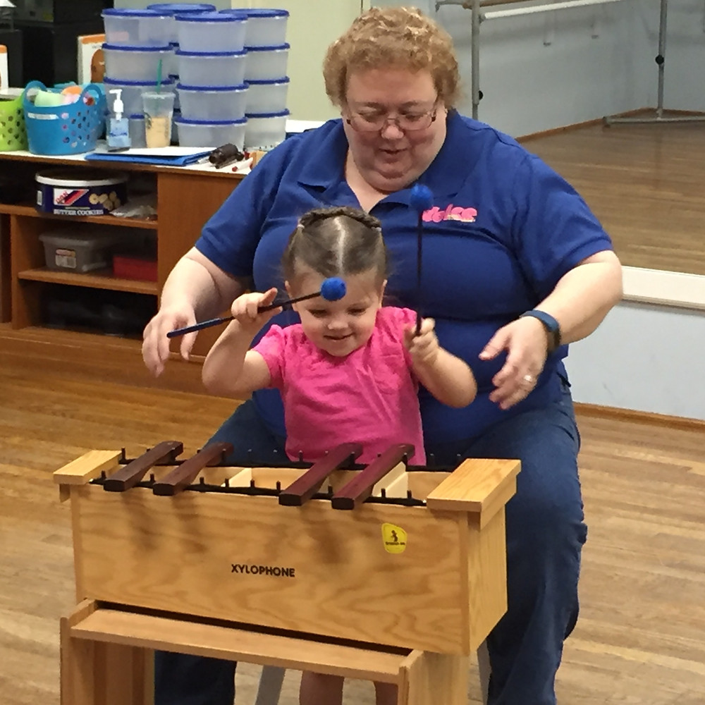 Preschooler plays the xylophone by herself at a Suzuki Early Childhood Education class